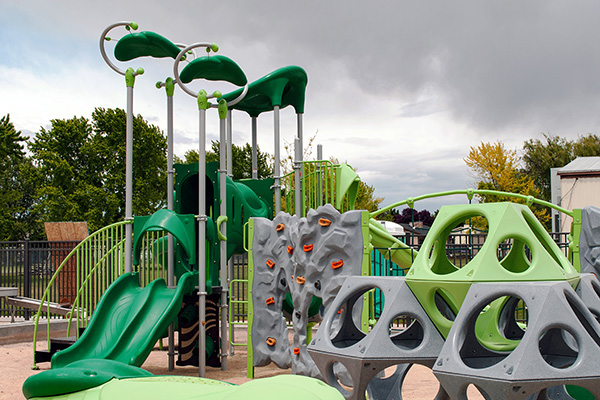 dōTERRA playground for children with autism features slides, a rock climbing wall, and multiple interactive spaces
