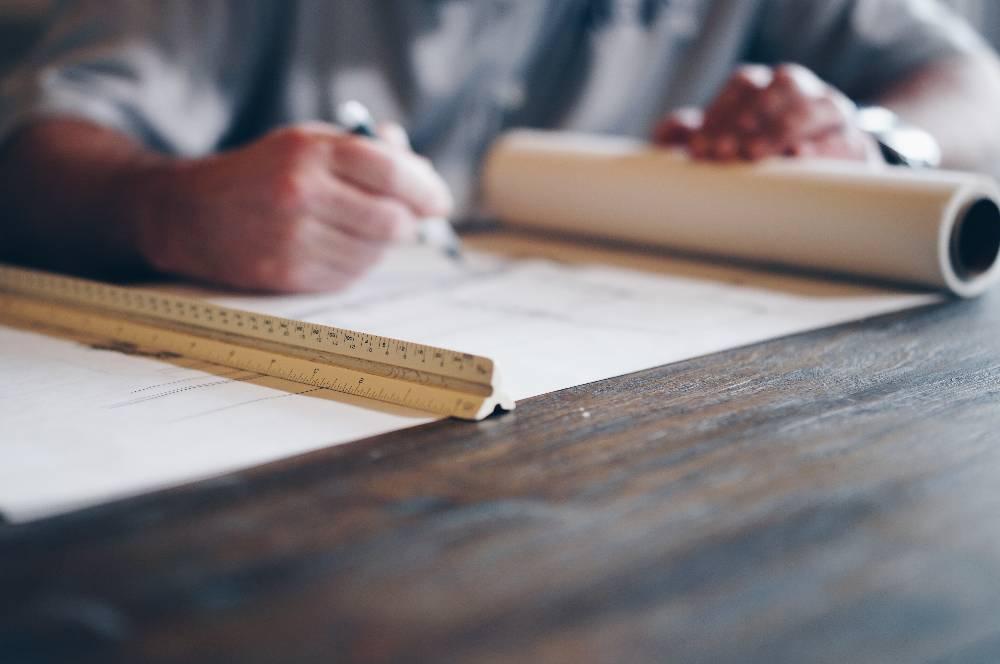 Architect Writing on Blueprints