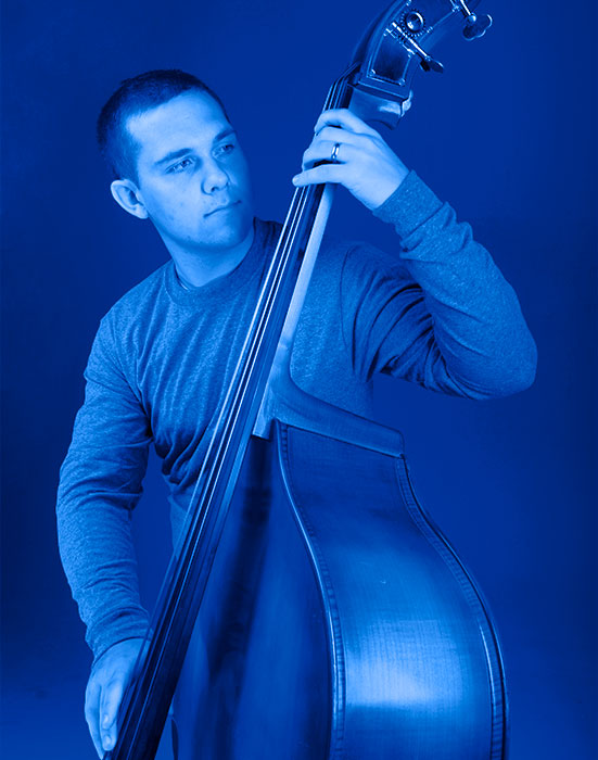 Guy playing an upright bass