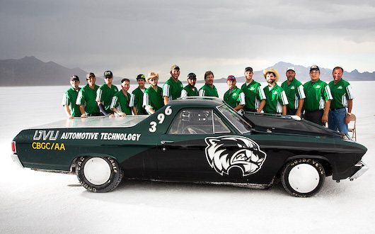 UVU race team with their race car on salt flats