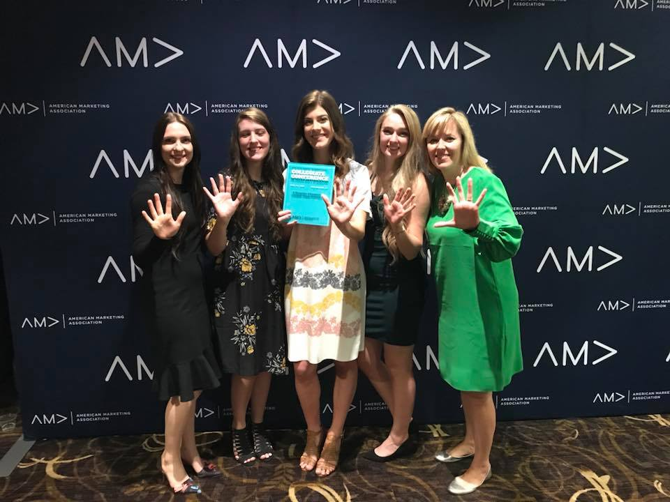 Female UVU students posing with award recieved