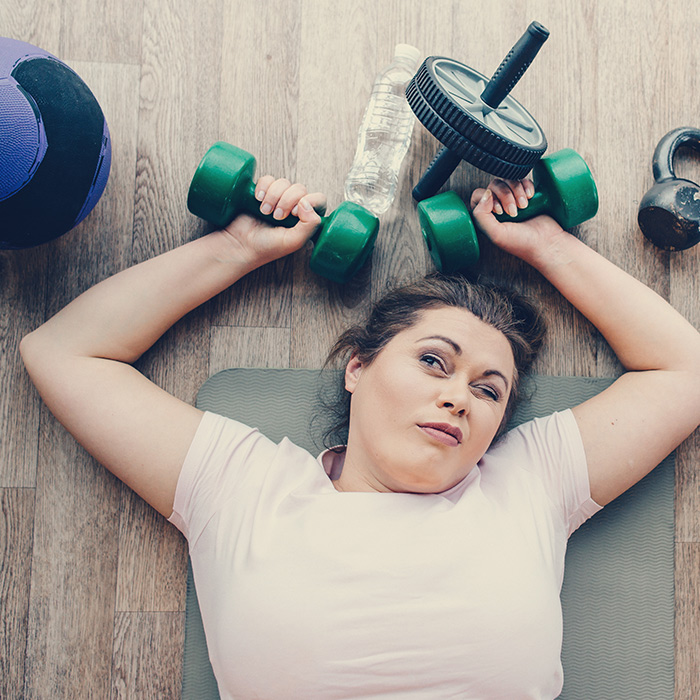 Woman laying on the floor after workout