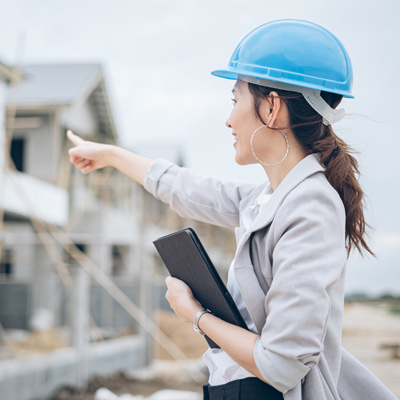 Woman inspecting residential building