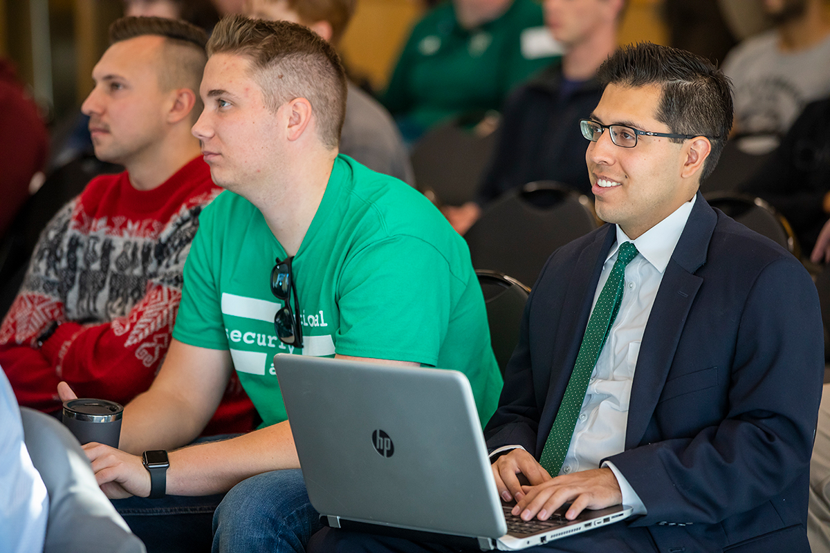 Students take notes at the cybersecurity conference