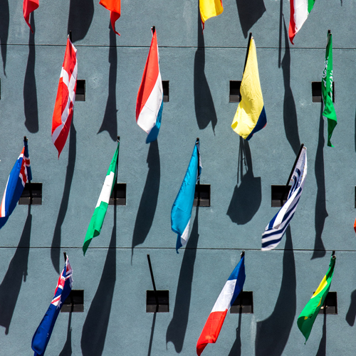 international flags hanging from a wall