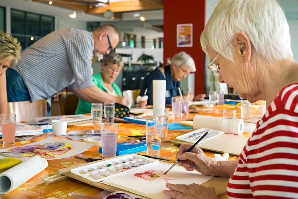 Elderly people in art class