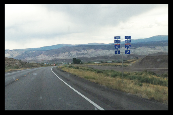 Signs for I-70 East and West on road side