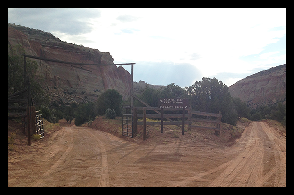 Fork in the road with sign for Capitol Reef Field Station and Pleasant Creek