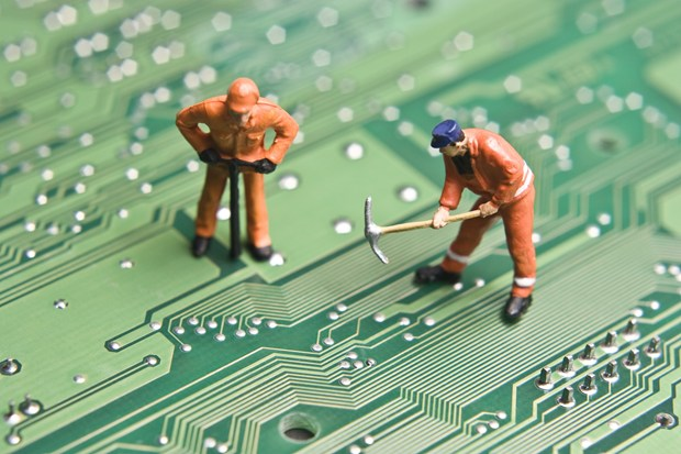 circuit board with construction workers