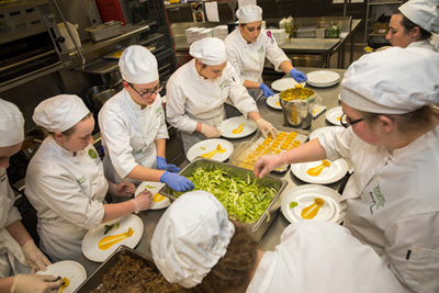 students preparing dishes