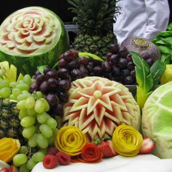 Carved melons with grapes and other fruit