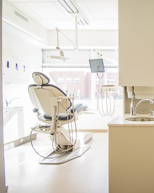 A picture of an empty dental chair from the back