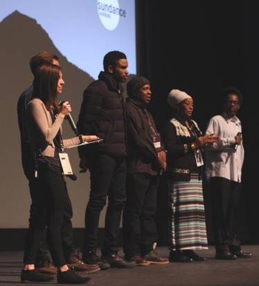 Aimee Olsen on stage with filmmakers