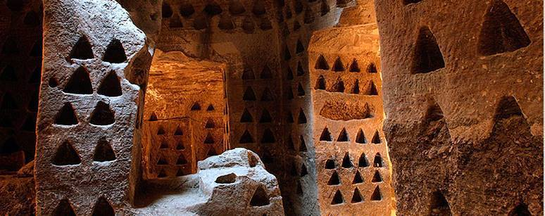 A Columbarium or dovecote with triangle shaped holes carved into the walls of a cave for turtle doves