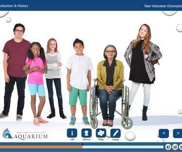 Screenshot of Loveland Living Planet Aquarium Website showing students, children, and older woman in a wheelchair