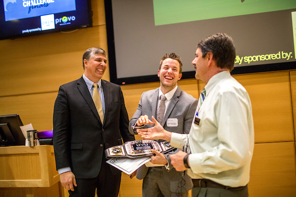 Kevin Shurtleff and Austin Bettridge with Mark Seastrand accepting Social Innovation Challenge 1st place prize.
