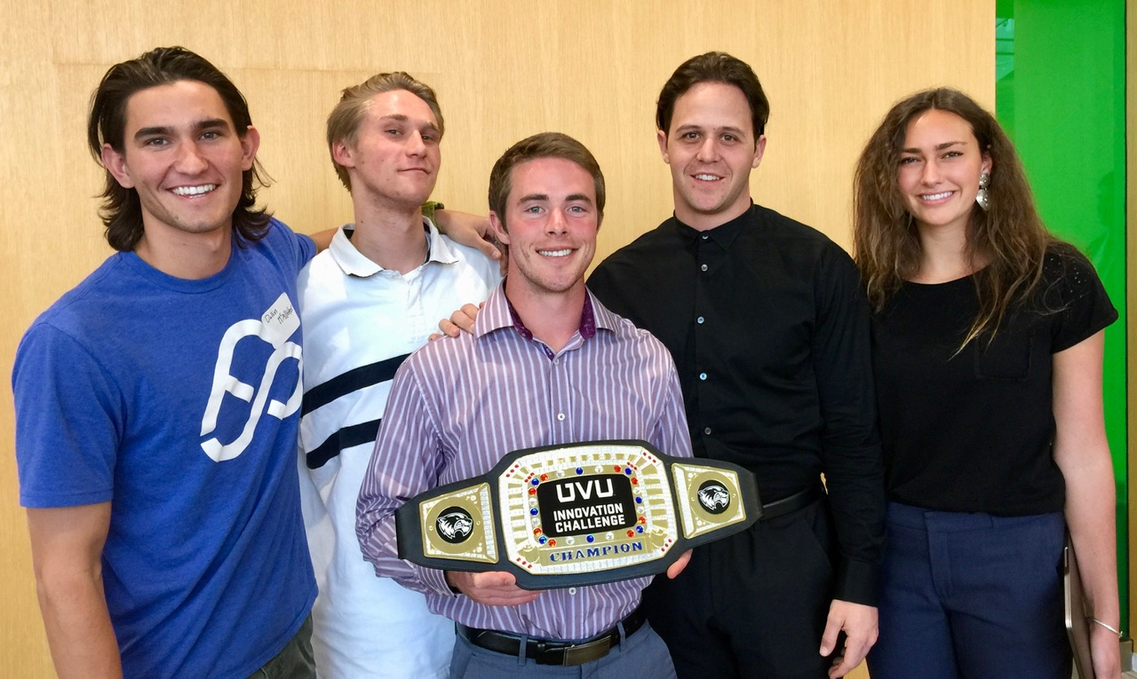 Dallin McAllister, Steven Robison, Matt Wilcox, Kade Andrus and Sydney Yarro with the Social Innovation Challenge belt.