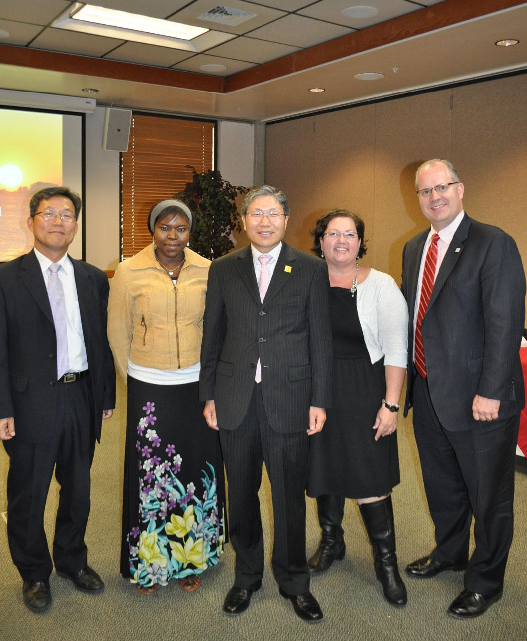 Consul General Han & Consular Agent David Lee with Marie Poudiougou, Amy Barnett & VP Cameron Martin from UVU