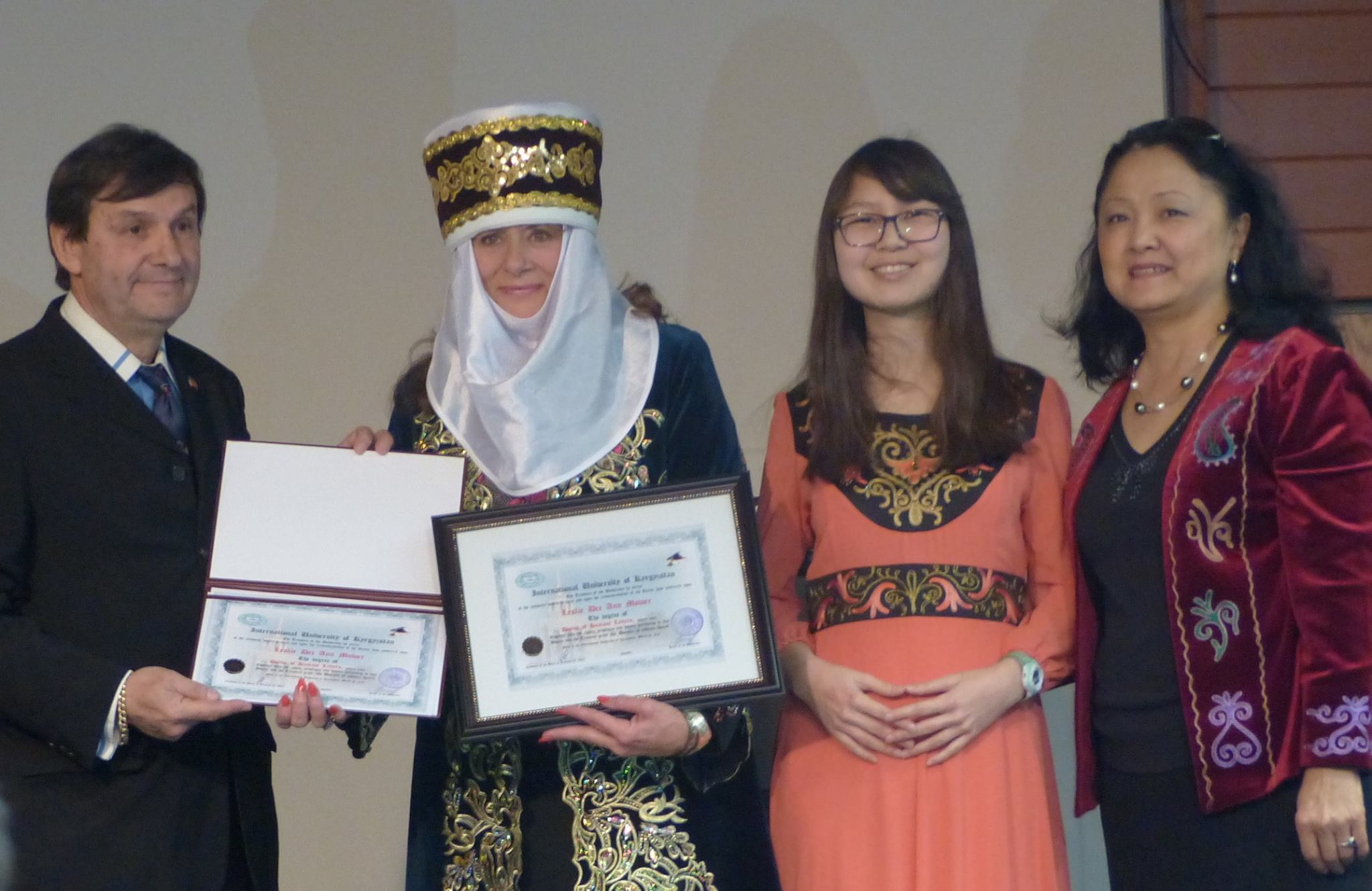 Leslie Dee Ann Mower receives an Honorary Doctorate of Humane Letters from Kyrgyz International University.
