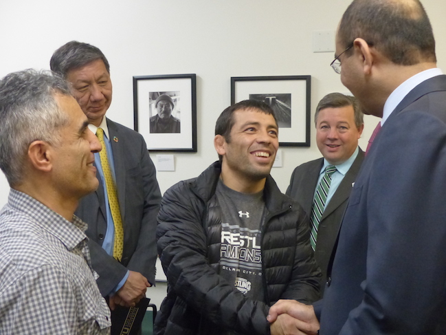 UVU's own assistant wrestling coach, Erkin Tadzhimetov (also from Uzbekistan) meets with Ambassador Madrakhimov.