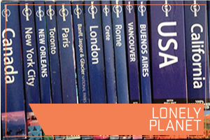 Lonely Planet. Image row of books on different countries