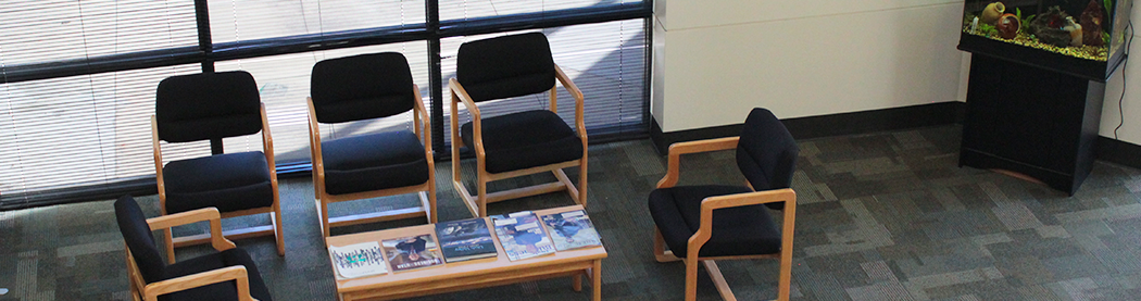 business resource center lobby with seating area, magazines, and fish aquarium