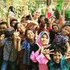 Children in photo making the peace sign