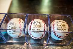 custom baseballs with the UCCU Ballpark logo and event date, signed by President Holland