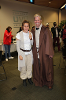Two people dressed as jedi from starwars