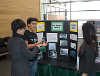 Students talking about their posters