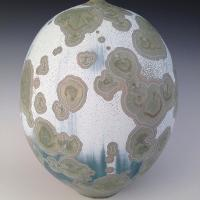 egg-shaped sculpture with grey dots