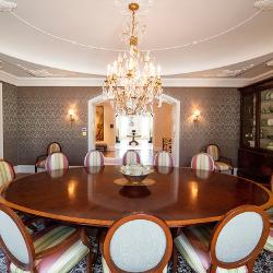 A large table set among luxe patterns