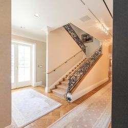 Plush rugs lead to the back stairway