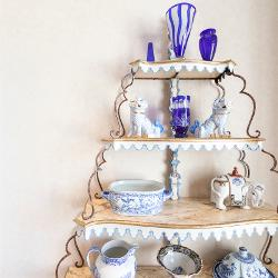 Eclectic blue keepsakes displayed inside the home