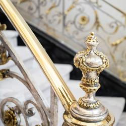Detail shot of the ornate two-tone banister