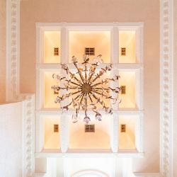 An upward view of the large entry chandelier