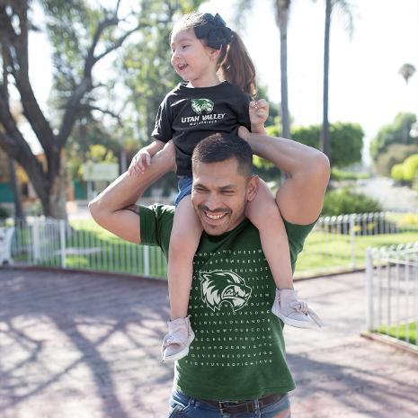 Man with child on his shoulders.