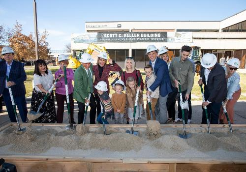 The Keller family breaks ground