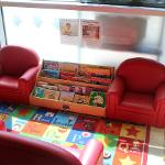 Red couches and books