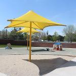 yellow umbrella in sandbox
