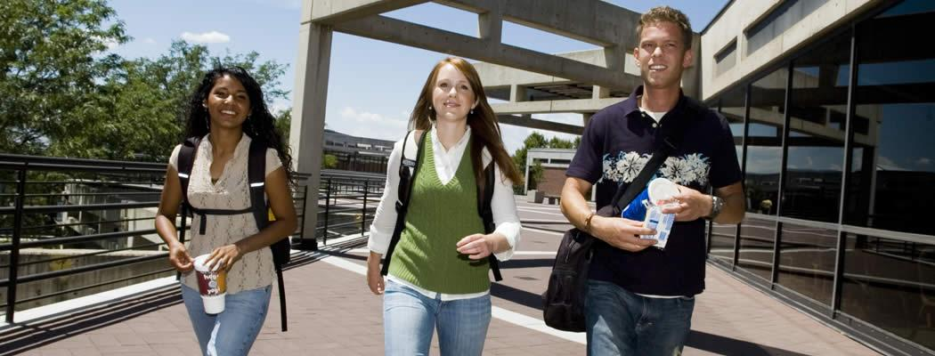 Three students walking on the UVU campus
