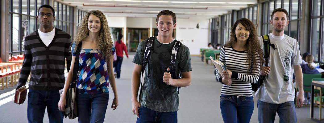 Five students walking down a hallway on UVU main campus