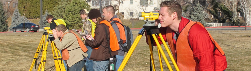 Students learning Surveying