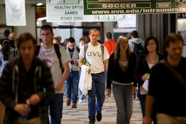 Students walking down the Student Center hall