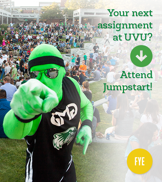 """One of UVU's """"green men"""" pointing his finger at the camera. Caption: Your next assignment at UVU? Attend Jumpstart!"""