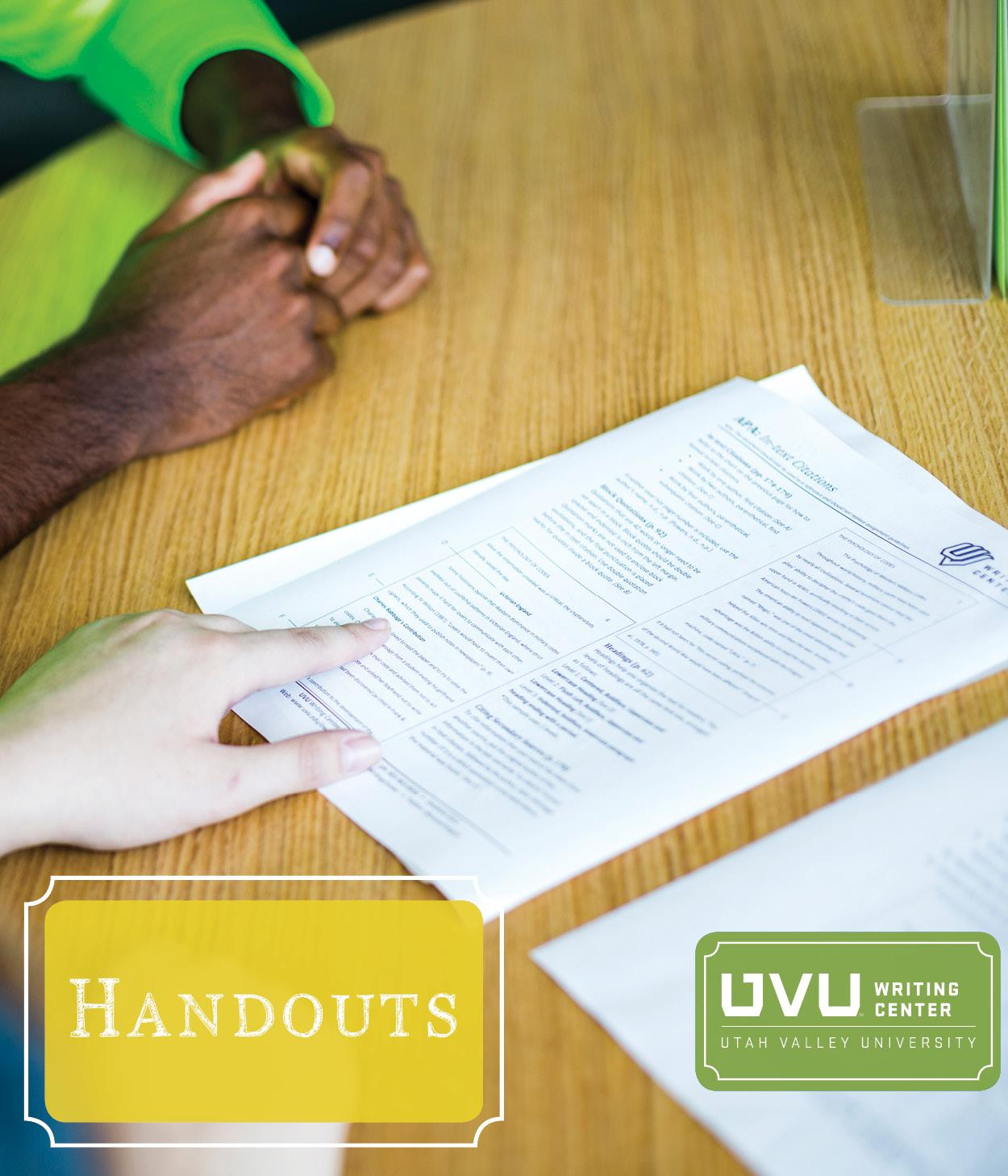 Image of tutor showing student a handout