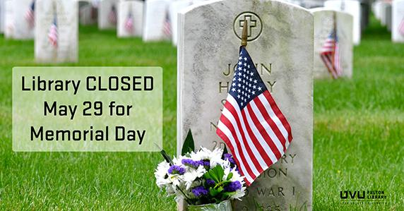 Grave stone with american flag. Library closed may 29 for memorial day.