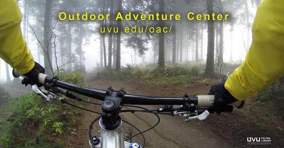 Mountain biker in woods. ad for outdoor adventure center.
