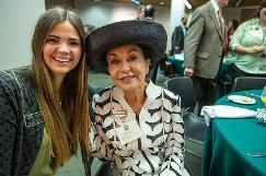 Barbara Barrington Jones and student ambassador Kylie McGill pose for a picture together