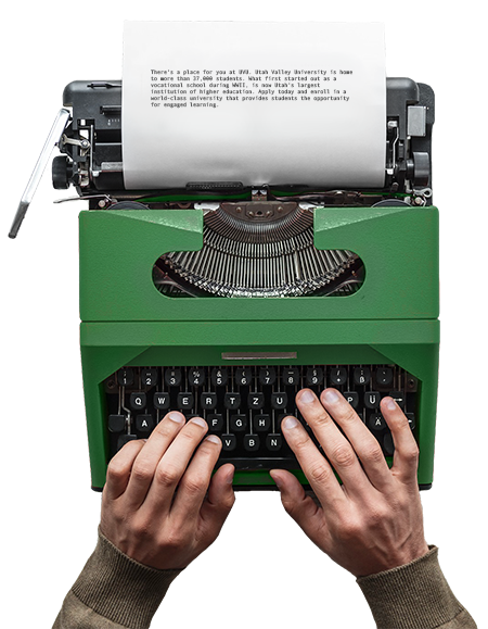 Hands typing on a typewriter.